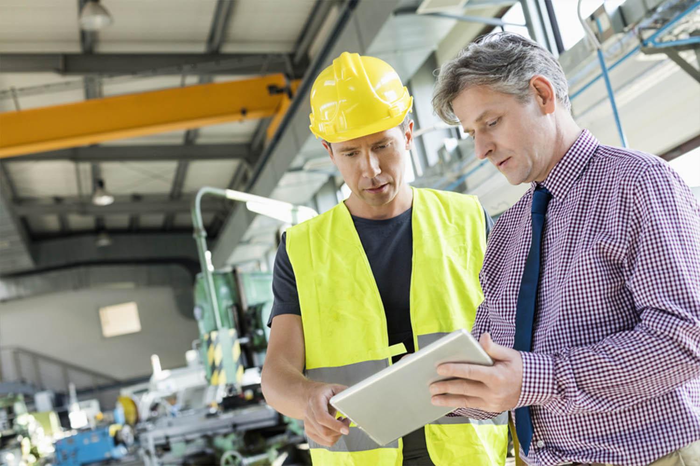 Industrial workers talking